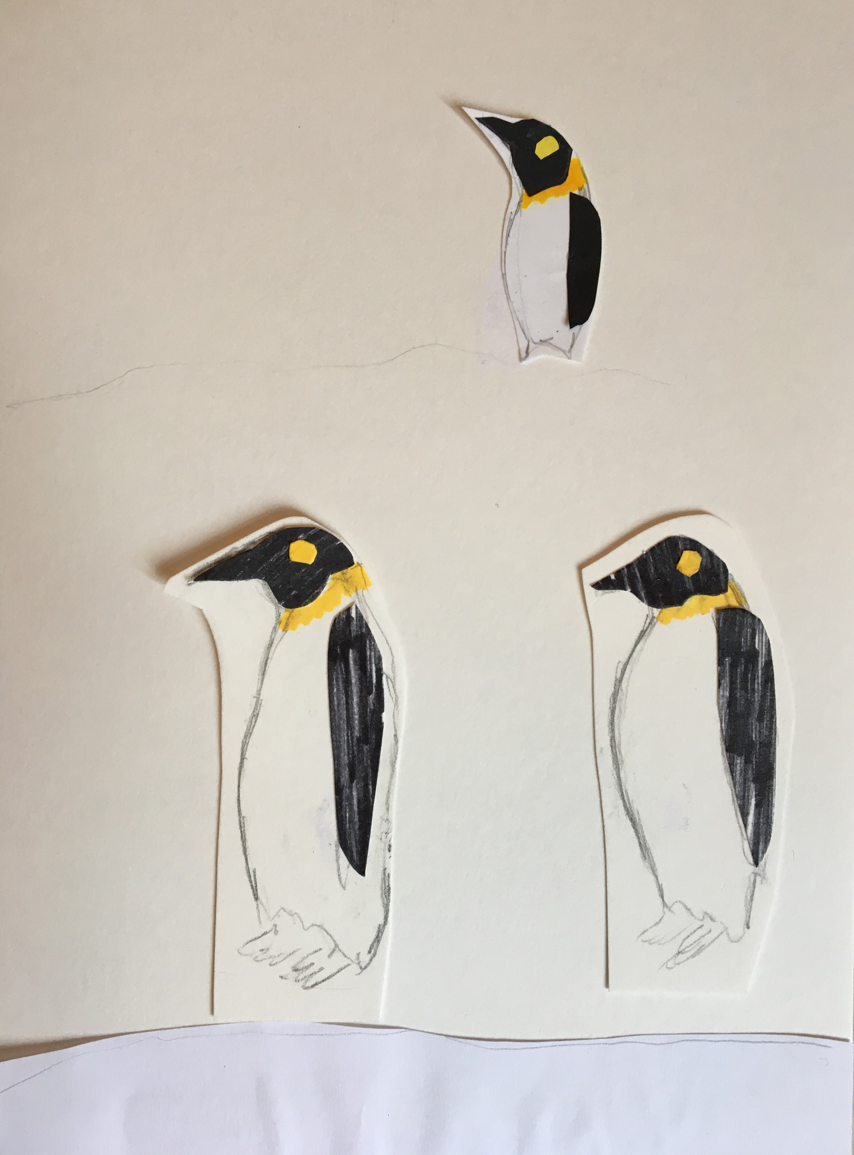 3 cut out drawings of penguins