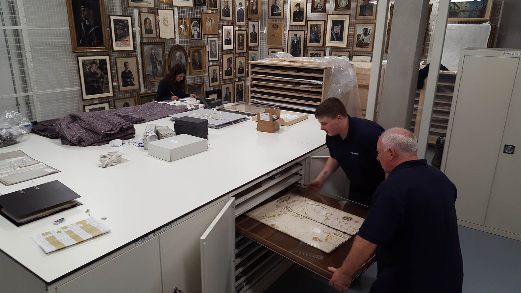 Image of Constantine technicians installing charts in new cupboards
