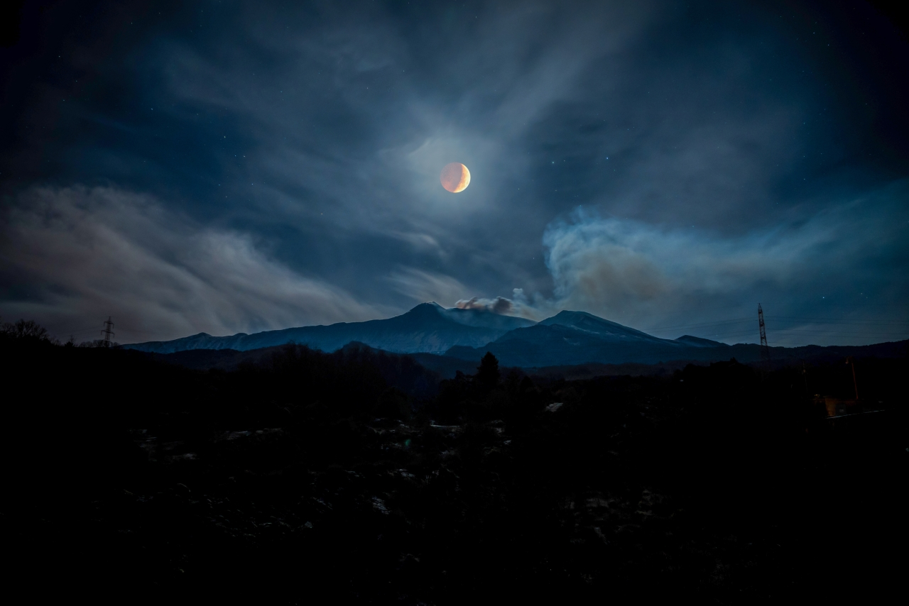 Moon Eclipse over Mount Etna by Alessia Scarso Our Moon Astronomy Photographer of the Year 2019