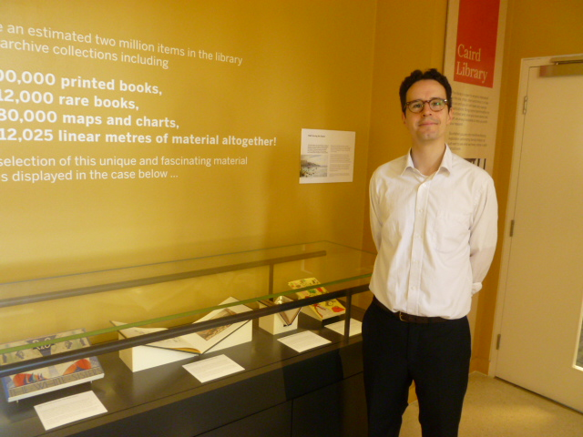 Daniel Davies by the display at the Caird Library