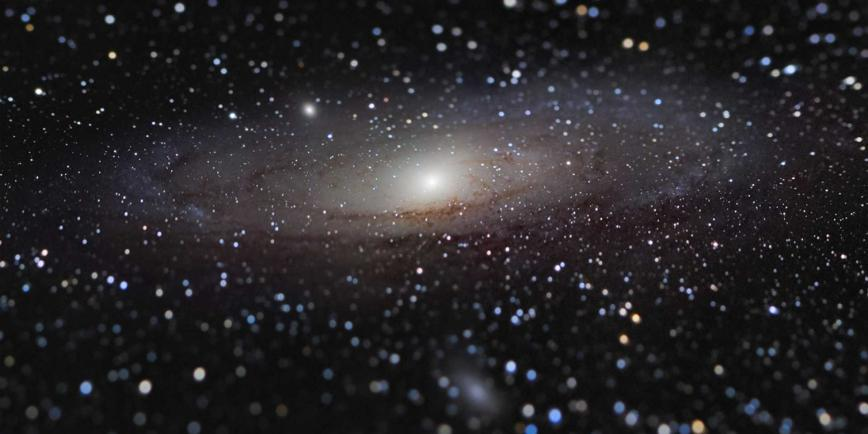 Photo of the Andromeda Galaxy - a dark black sky sprinkled with stars