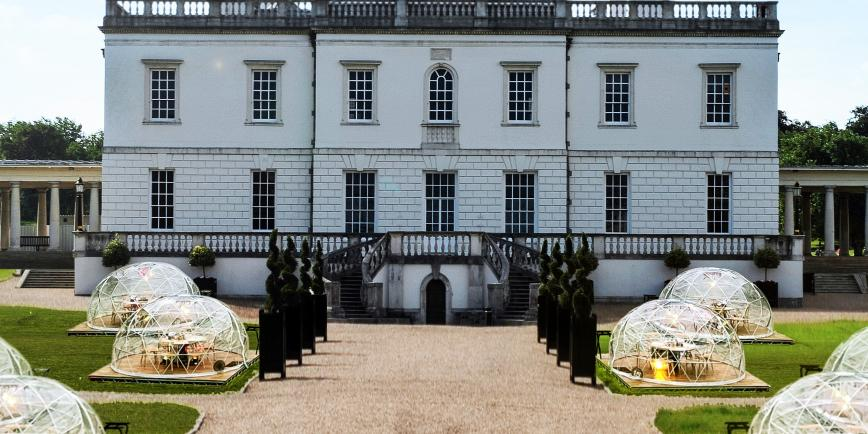 The Queen's House in Greenwich, with rows of outdoor dining pods on the lawn in front