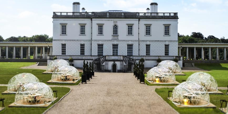 The Queen's House in Greenwich, with a series of outdoor dining pods on the front lawn