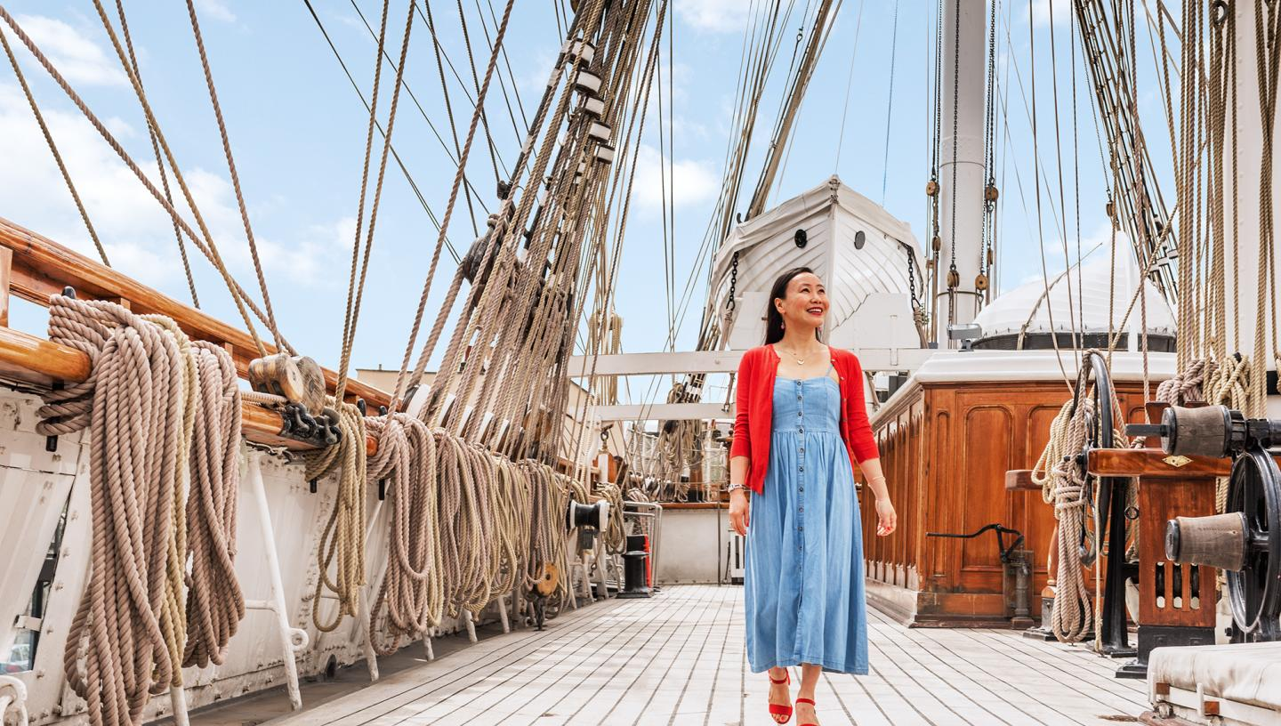 A woman walks along the main deck of Cutty Sark