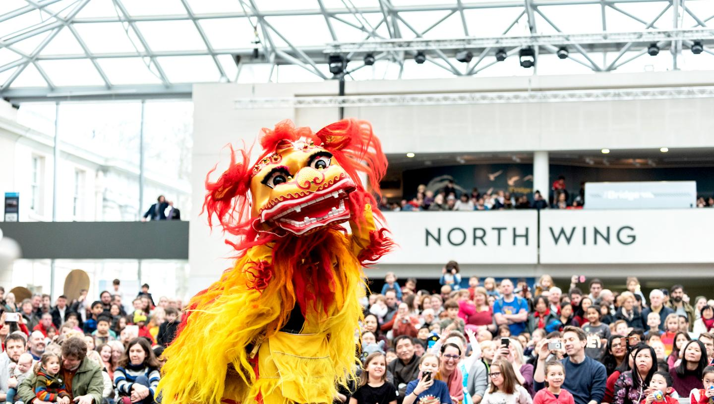 A dragon performance taking place at the National Maritime Museum during Chinese New Year