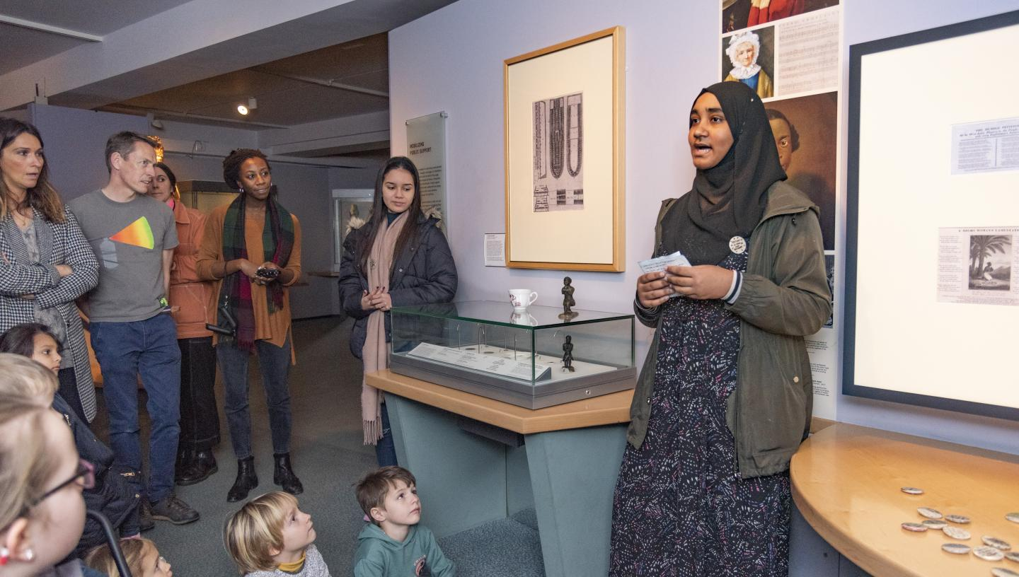 A young person delivering a tour in the galleries