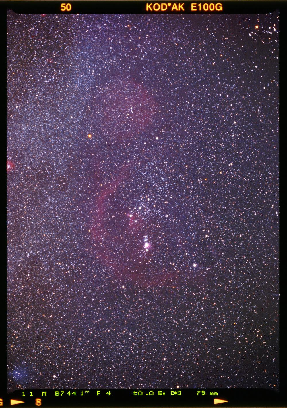 An image showing ''Slide' to the past - Orion Constellation and its nebulas on positive film'