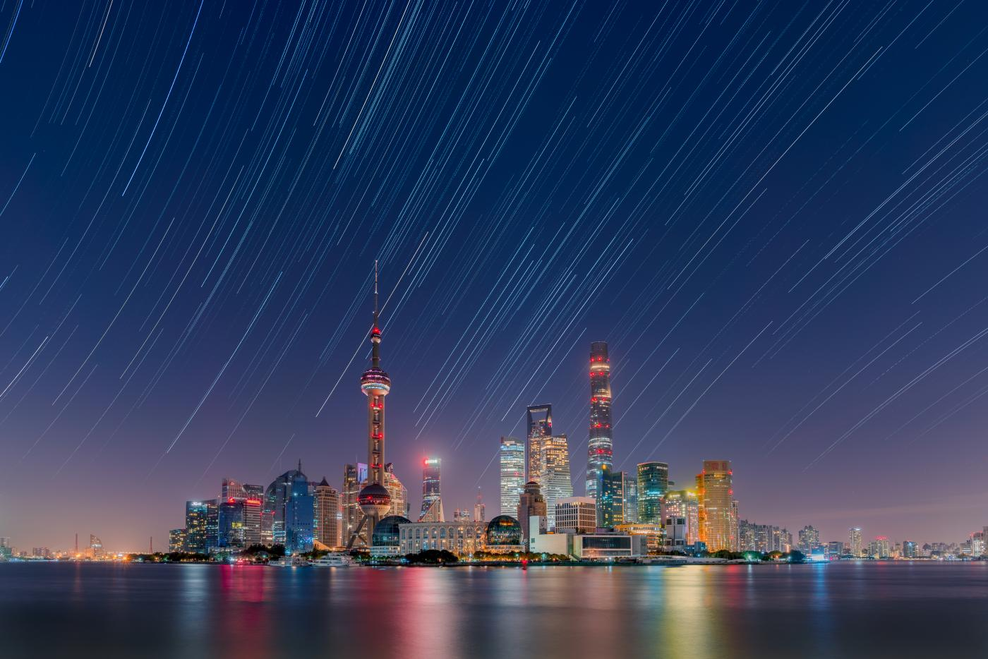 An image showing 'Star trails over the Lujiazui City Skyline'