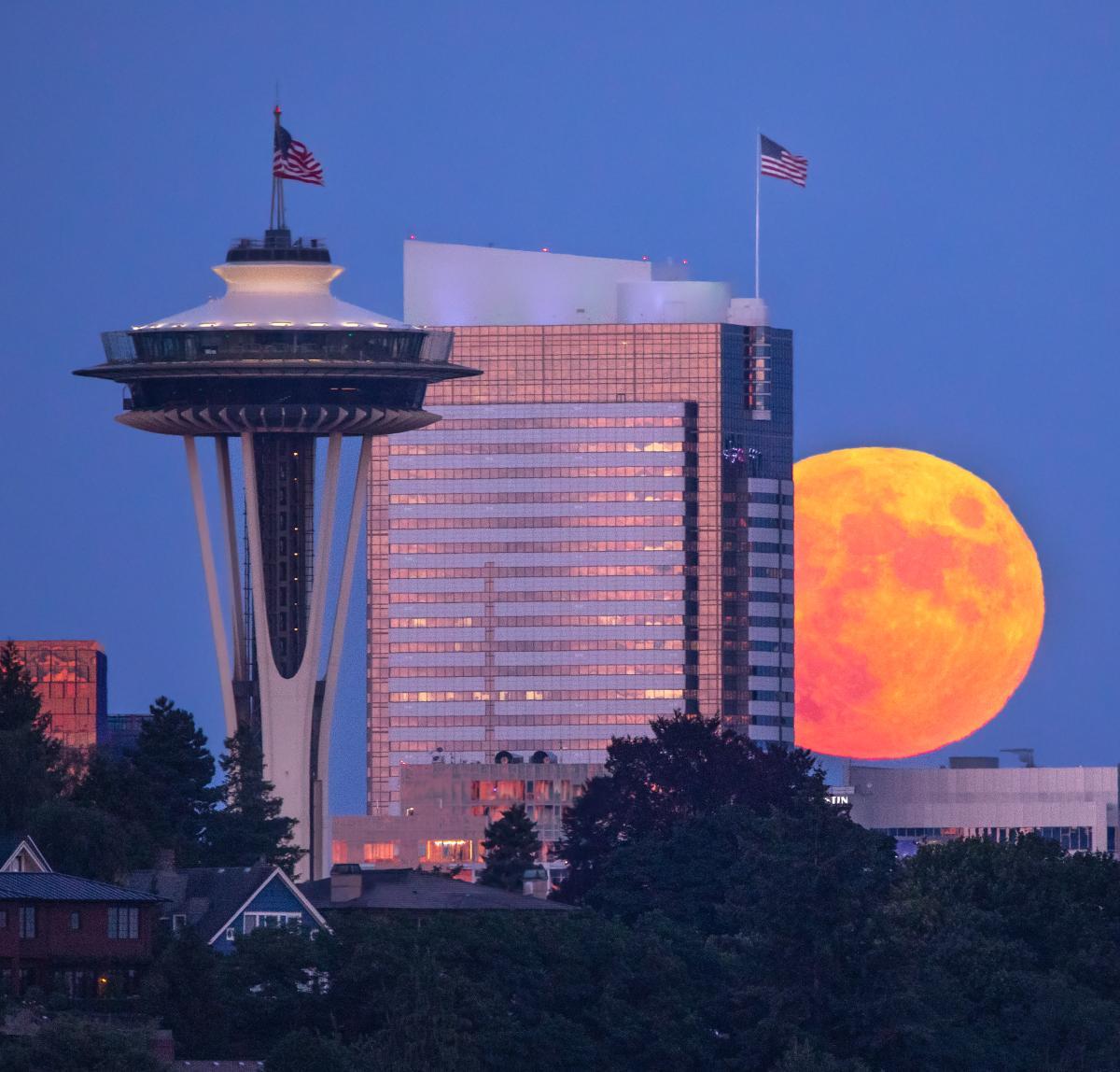 Orange full moon rising in Seattle, USA