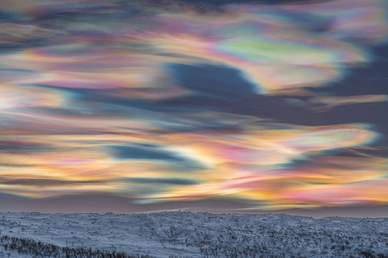A photo of multi-coloured Nacreous clouds filling the sky