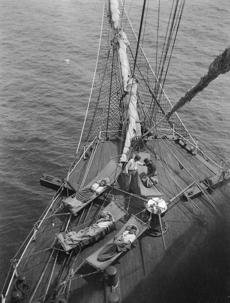 Crew relaxing in hammocks on the Parma in 1902