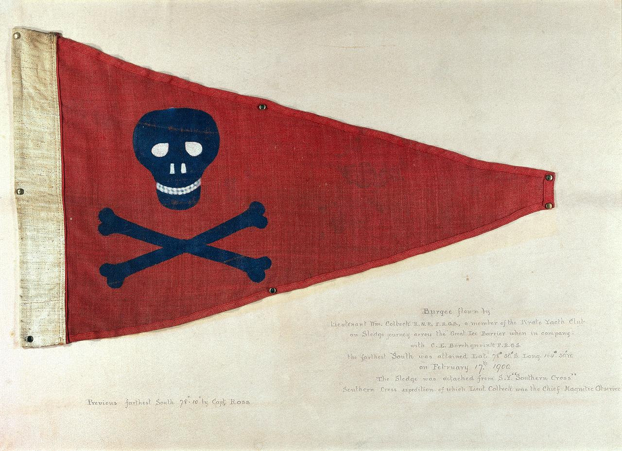 A red triangular flag with a black skull and crossbones