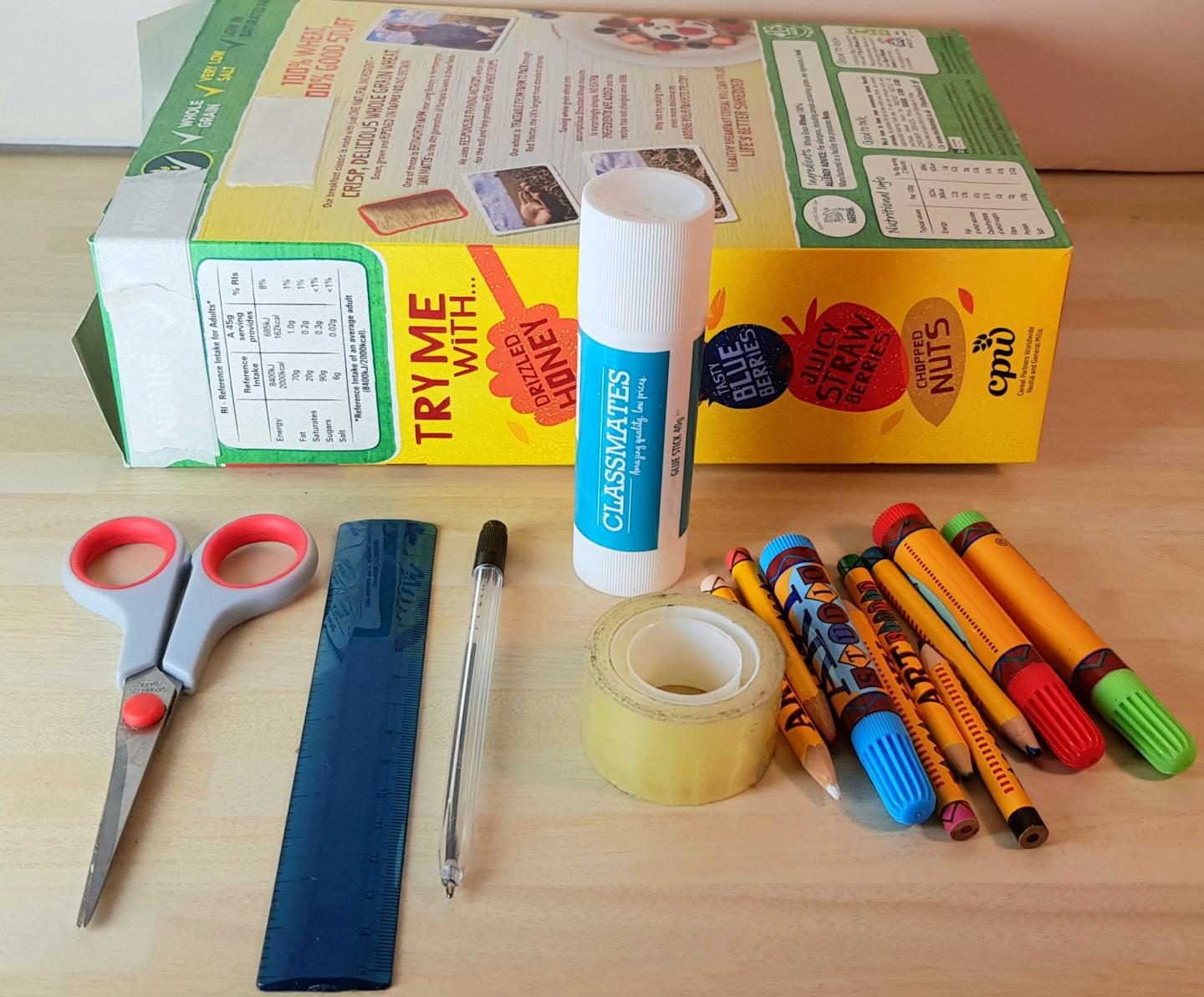 cereal box, glue stick, scissors, ruler, tape, pen, coloured pens and pencils