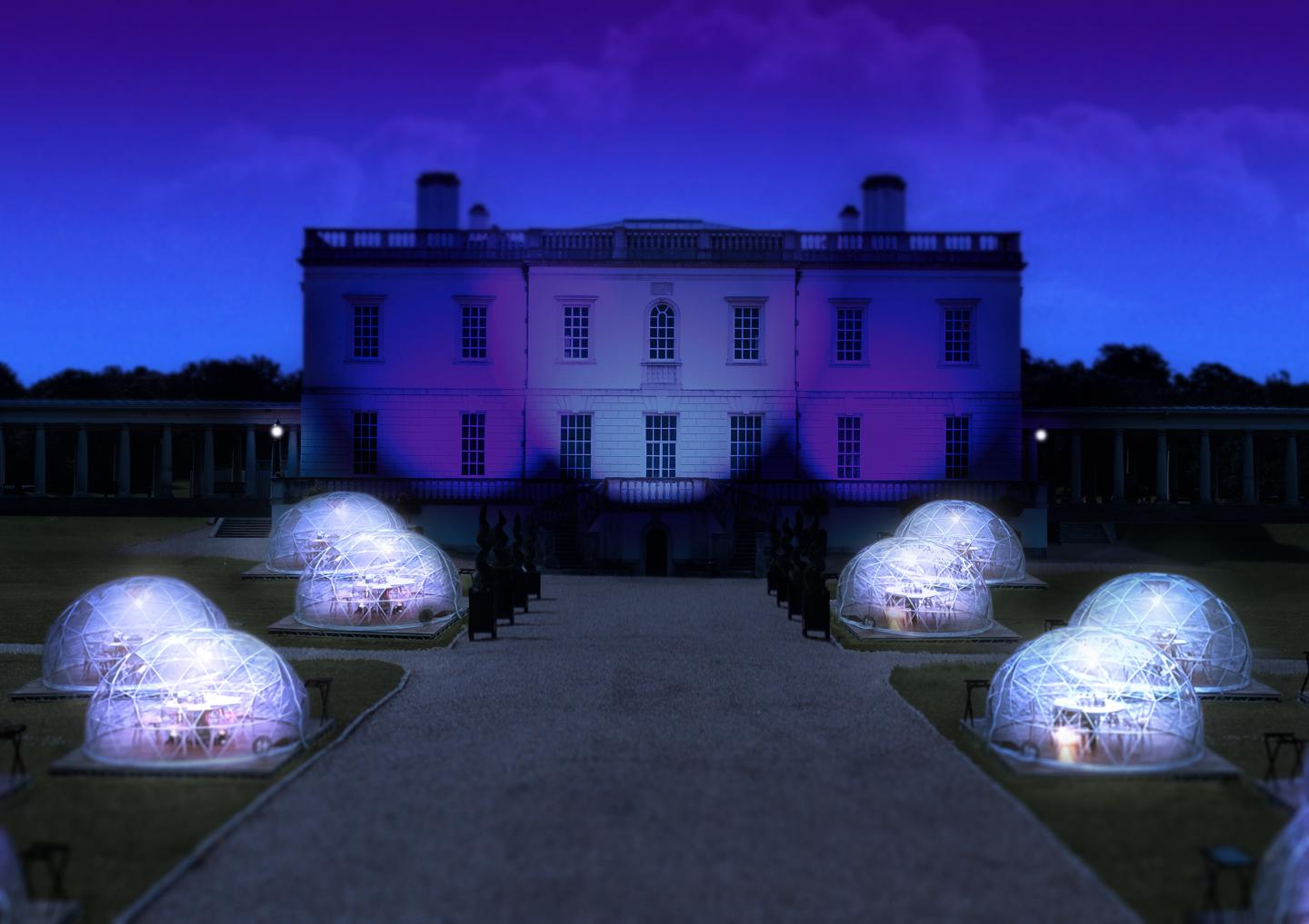 The Queen's House Greenwich at night, with a series of outdoor dining pods arranged on the front lawn