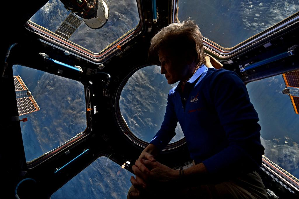 NASA Astronaut Peggy Whitson aboard ISS above Earth. Image credit: NASA