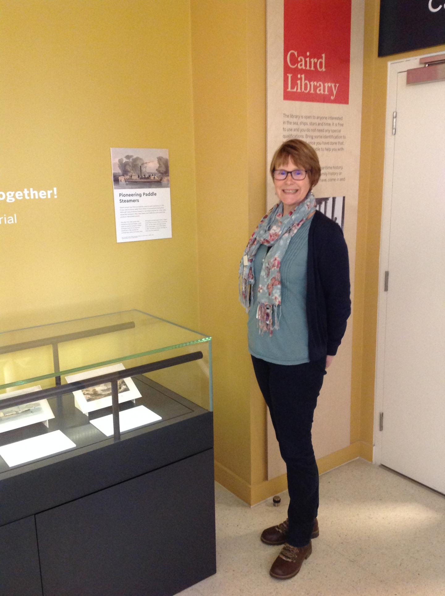 Jenny Collett by the Caird Library display case
