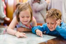 Children reading maps at Cutty Sark Greenwich