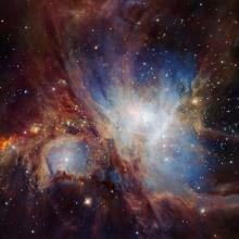 Orion Planetary Nebula, red dust clouds and bright blue stars