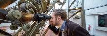 An astronomer looking through the Great Equatorial Telescope at the Royal Observatory Greenwich