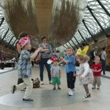 Families enjoying the space created in the dock by lifting the ship ® National Maritime Museum