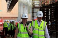 Lord Sterling, Chairman of Cutty Sark Trust, and Carole Souter walking underneath Cutty Sark after the ship had been successfully raised © Cutty Sark Trust