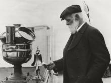 Captain Woodget (Master of Cutty Sark 1885-1895) inspecting the ship's bell in 1924 © Cutty Sark Trust