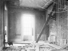 The first studio image: a glass plate negative of a room on the ground floor of the Queen
