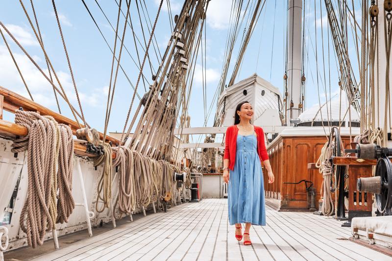 A woman walks along the main deck of Cutty Sark