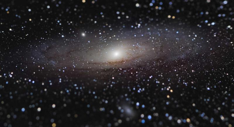 Photo of the Andromeda Galaxy - a dark black sky sprinkled with stars
