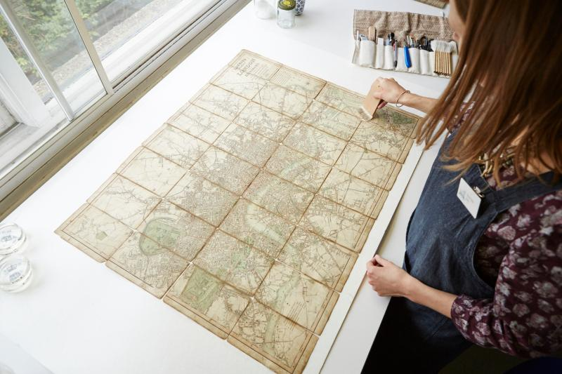 Paper conservator working on a chart