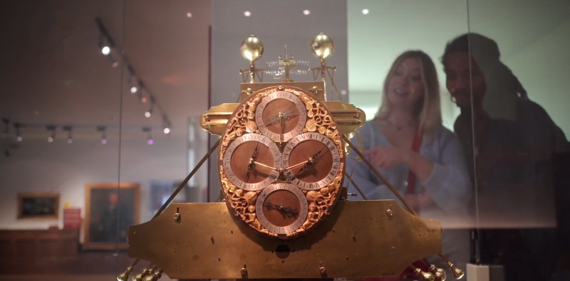 Man and woman looking at Harrison's clocks