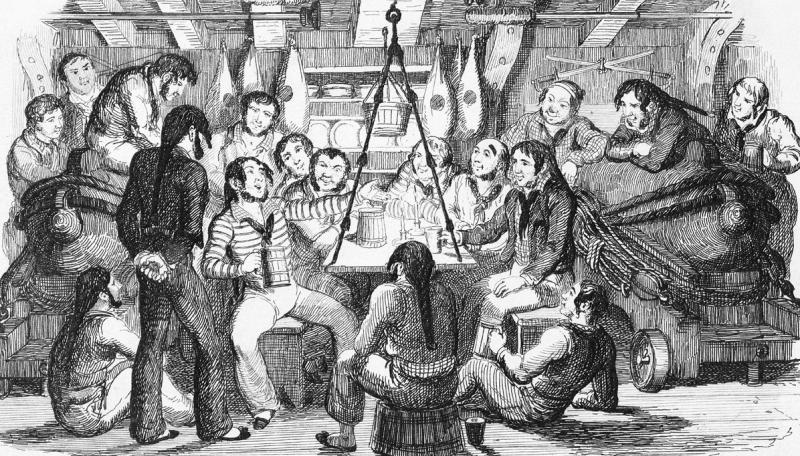 A black and white etching of a raucous scene below decks, with sailors sitting round a fireplace