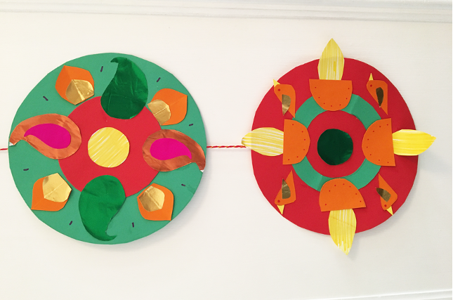 two rangoli diwali decorations one made on a green circle and one on a red circle.