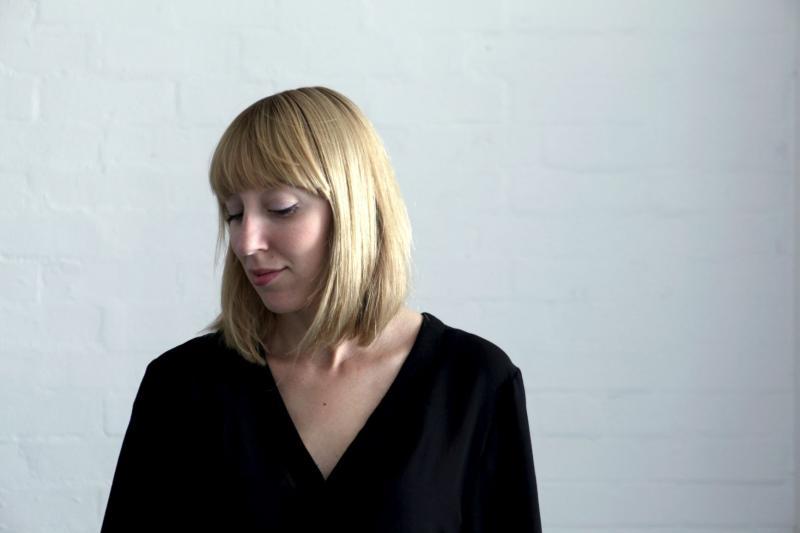 A colour portrait of artist Katie Paterson