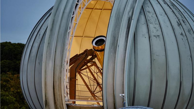 The Great Equatorial Telescope at the Royal Observatory at twilight, with the onion-shaped dome partially open
