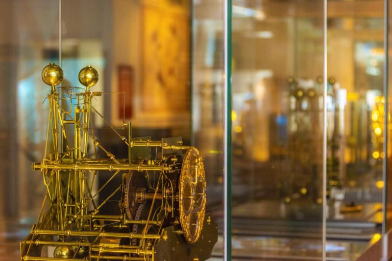 A beautifully intricate clock inside a display case at the Royal Observatory