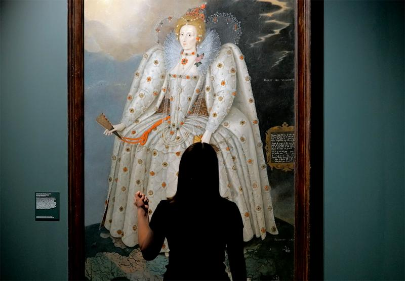 A young woman gazes up at the Ditchley Portrait of Elizabeth I