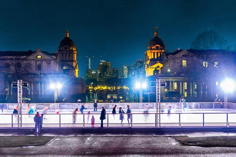 A landscape view of the Queen's House Ice Rink in Greenwich at night