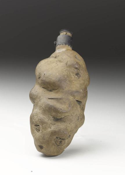 An earthenware spirit flask irregularly shaped like a potato from 1783